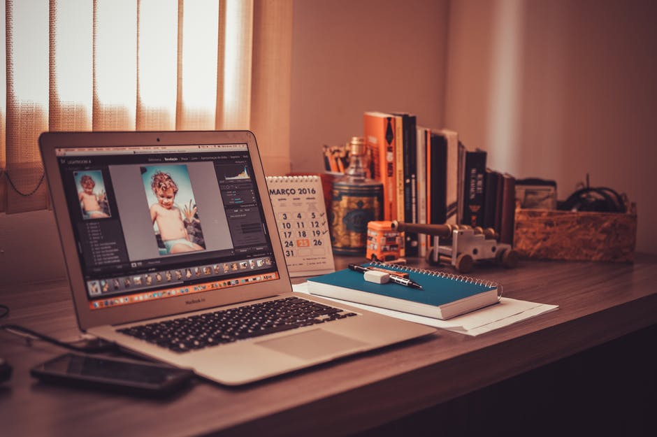 Photoshopping Portraits on a Laptop